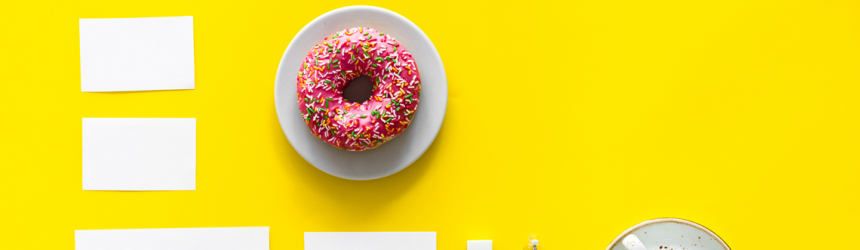 donut and coffee on yellow background